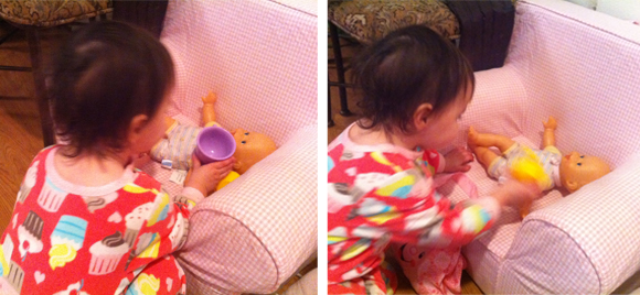 Madelyn treats her baby like a queen with a cup o' tea in the face AND a force feeding of Fisher Price mustard.