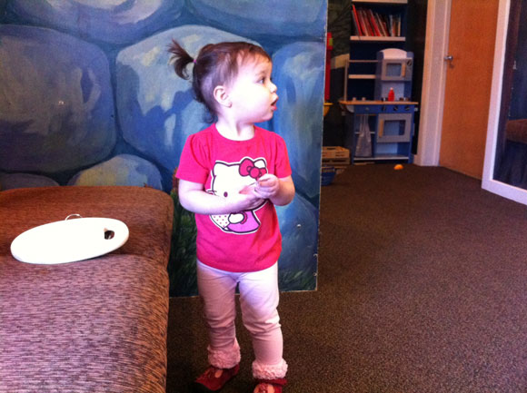 Madelyn takes in the kid-friendly surroundings in the waiting room.