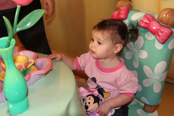 Madelyn enjoys germ-infested plastic tea and cookies that I would not let her touch at Minnie's table.