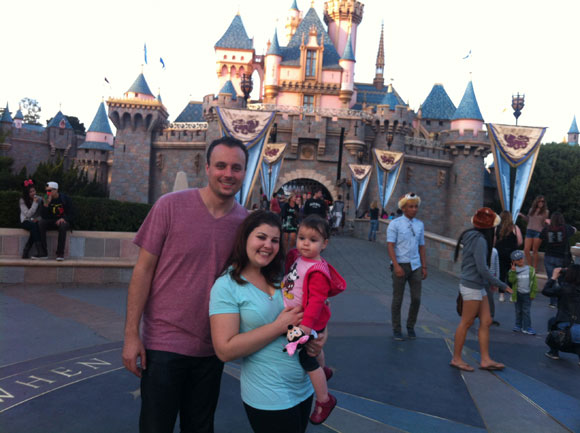 Our little Disney family... and the dude in the weird hat and Miss Legs in front of him. Oh well.