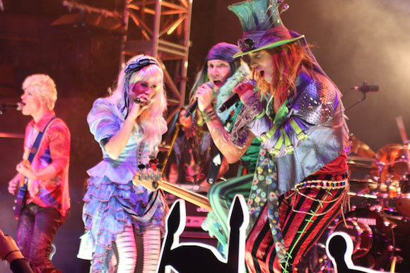 George is in the middle and rockin' out with Alice and the Mad Hatter!