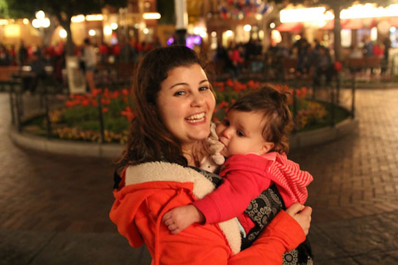 A sleepy Madelyn holds onto the last remaining moments at Disneyland.