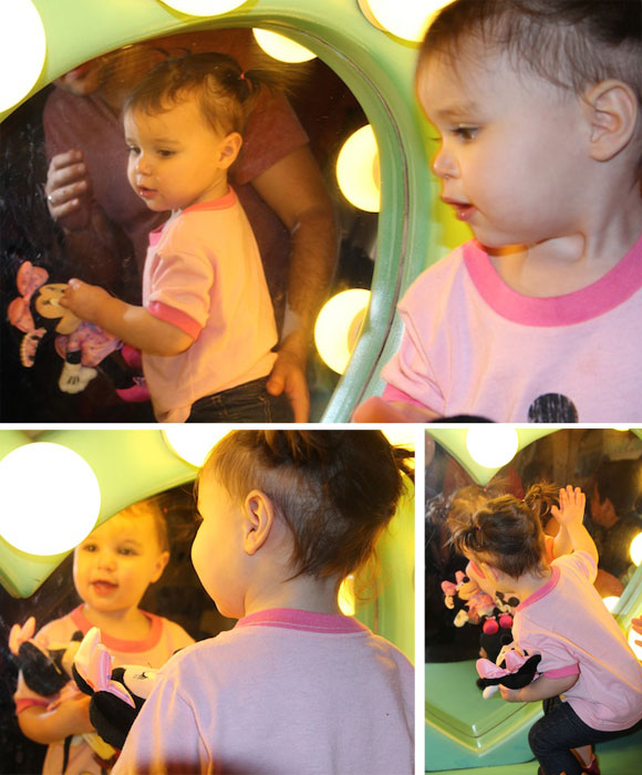 Madelyn admires herself in Minnie's mirror.
