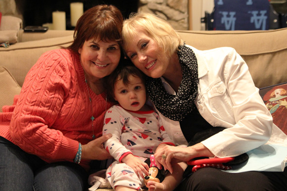 The Sweet 60th End: Madelyn cuddling up with her Mimi and Grandma waaaaay past her bedtime.