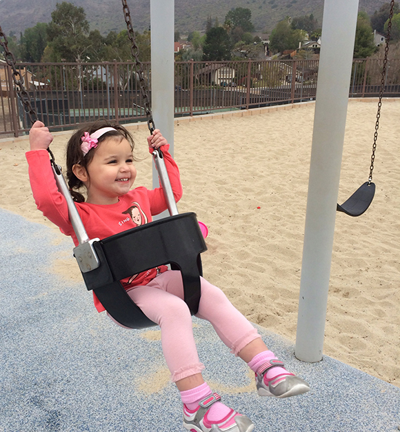 Madelyn on swing