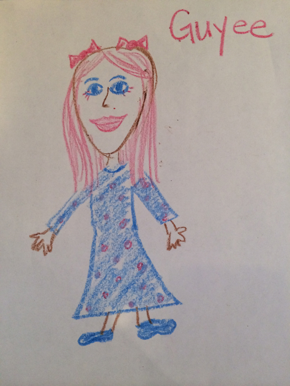"""Madelyn says, """"Guyee has a blue dress with pink polka dots. She has pink hair with pink eyelashes and blue eyes. She wears a bow. NO TWO bows. They are pink. And shoes. They're bwoo."""""""