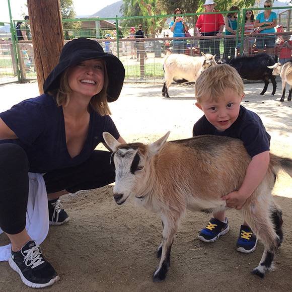 Look at that blonde cutie pie! Oh and look at the goat too!