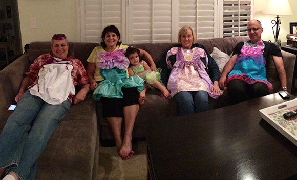 Madelyn dresses up her grandparents in all of her new costumes!