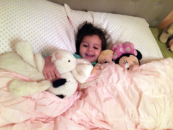 """Comfy and cozy"" surrounded by all of her friends. We are one stuffed animal shy from promoting her to a king size bed."