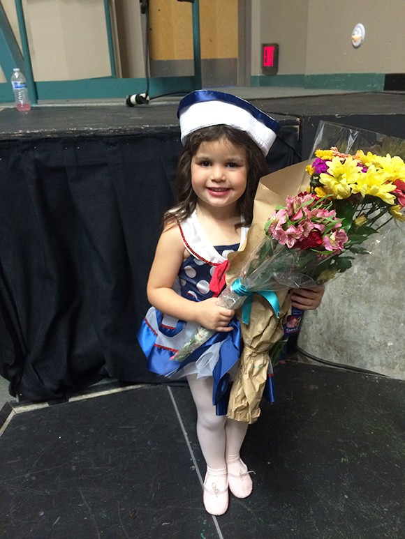 Madelyn loved getting flowers. She handled them like a true star. Soon we'll all be having to speak to her through her bodyguard and manager.