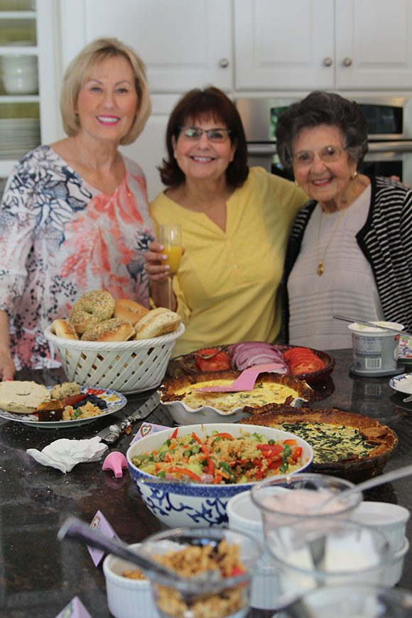 The original mothers at the brunch get first dibs at the buffet. Ironically, on Mother's Day, the mothers are out of focus and the focus is on the food. There is deeper meaning to this photo after all.