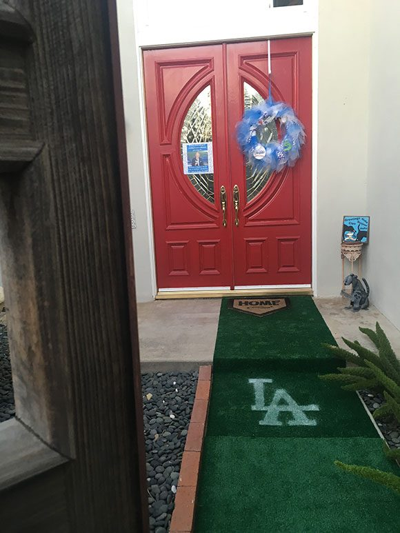A homemade LA stencil, white spray paint, and a cheap, ugly roll of fake grass took our guests from the driveway to THE FIELD!