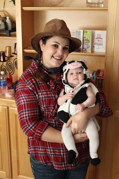 Madelyn's First Halloween. as a cow. I dressed up like a farmer and phoned in my costume that was a pre-existing outfit that consisted of a plaid flannel from Target.